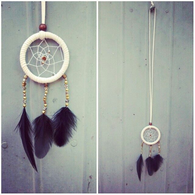handmade dreamcatcher necklace using faux suede (soft & durable), different kinds of beads , embroidery thread for the web and feathers!