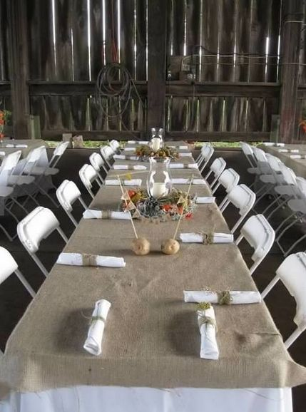 Long wedding tables with burlap - would go great with an outdoor fall park wedding.