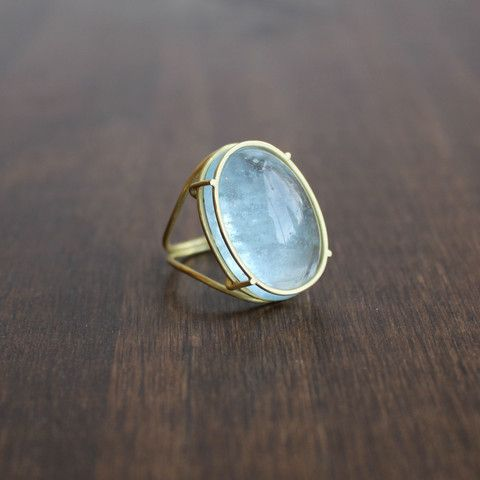 Rosanne Pugliese 18k Gold and Oval Aquamarine Ring in a cage setting. Available at Meeka Fine Jewelry.