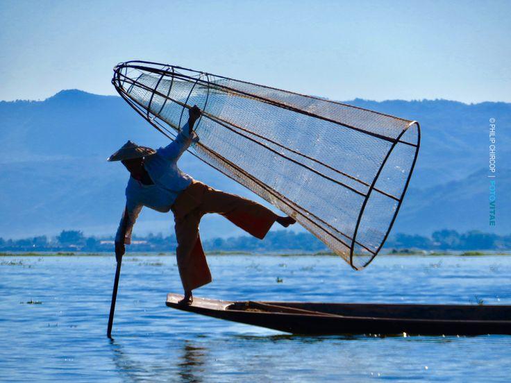 BALANCING ACTS II Leg-rowing fishermen on Inle Lake (Myanmar), playfully balancing his fishing net. (Photo by Philip Chircop)