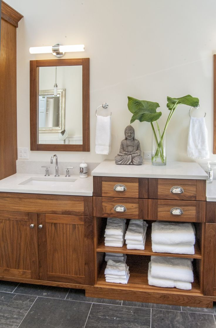 The Gardner/Fox team reconfigured the floor plan to accommodate a more spacious & luxurious master bath. The newly revamped master suite incorporates a large walk in shower, with two shower heads, his & her vanities, a freestanding pedestal tub and a makeup table with pendant lighting.