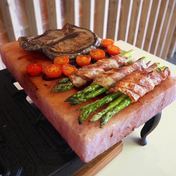 Perfectly seasoned steak and asparagus on our Rectangular Himalayan Salt Block