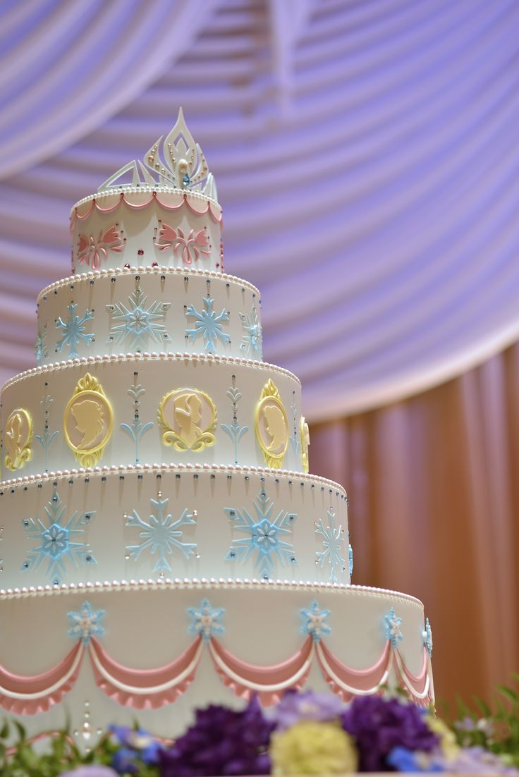 Frozen wedding cake at the Tokyo Disney Resort | Wedding cake inspiration | Disney wedding decor | [ https://style.disney.com/living/2016/03/25/tangled-and-frozen-weddings-launch-at-tokyo-disney-resort/ ]