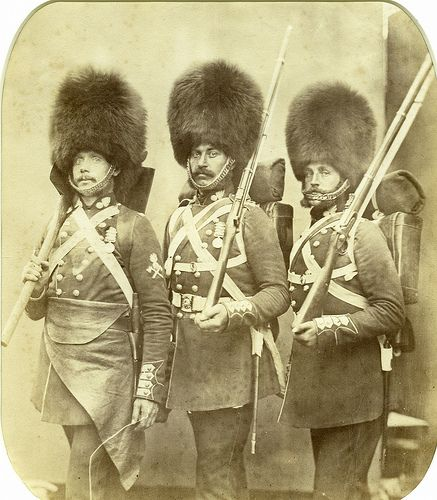 "Three men of I believe the Grenadier Guards. These are veterans of the Crimean War and was taken the same year the war ended; this being 1856. A series of photographs were commissioned which this was part of entitled ""Heroes of the Crimean War"" These were taken by Robert Howlett and Jopseph Cundall.This particular image was taken by Cundall. The man on the far left is a pioneer. These were the men of the line regiments which took out obstacles of the way of the men such as battle..."