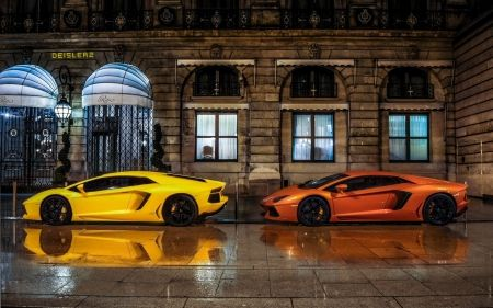 Two lamborghinis parked in front of the ritz.