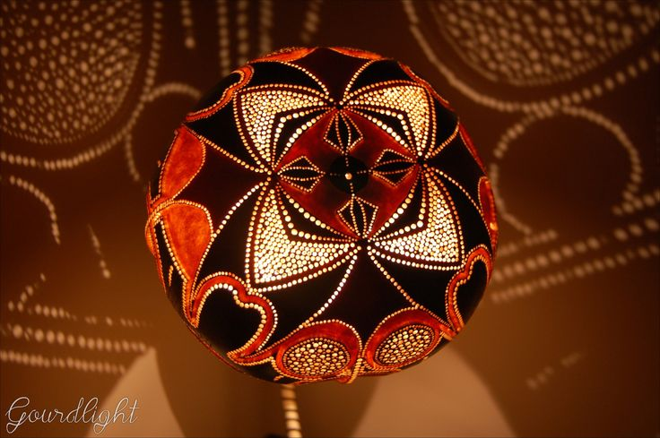Handmade gourd lamp. Stand is finished off with Brown and beige jewellery waxed string. Perforations in lampshade are made in 9 different diameters – starting from 0,6mm- show lightpattern of the g…