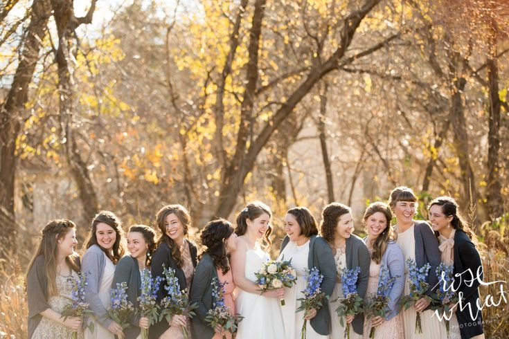 The bride had ten bridesmaids, and somehow they managed to blend their mismatched dresses beautifully. The blue stock bridesmaids bouquets on their blush and ivory dresses made for a beautiful perfectly pastel palette.