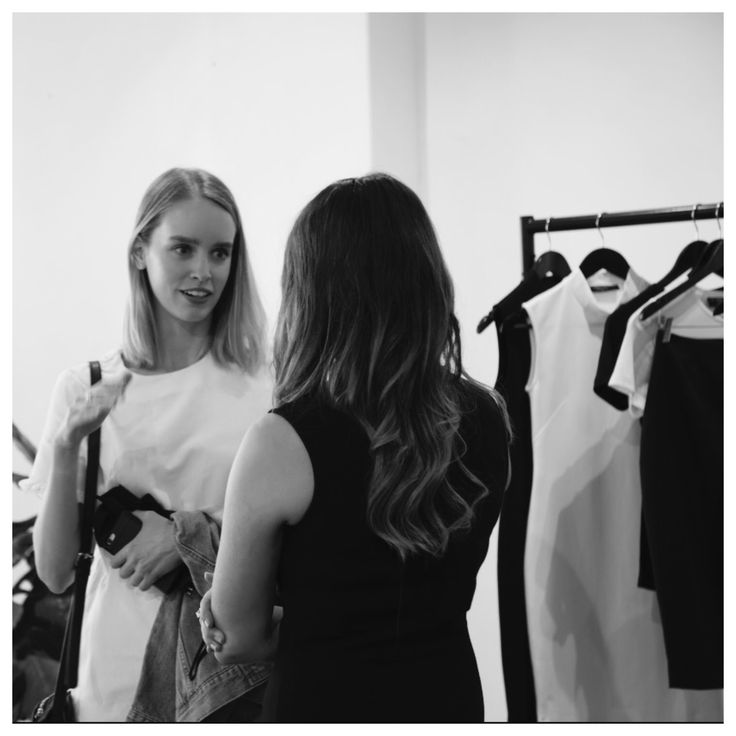 Founder, Ashley Freeman, walking guest, Emily Doherty, through The Aurum Collective's Season One collections at the label's exclusive showing in March 2017.