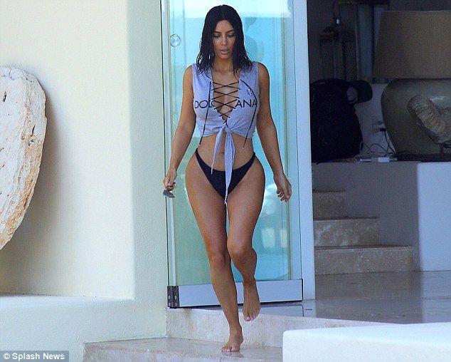 Kim Kardashian flaunts her hourglass figure in crop top and bottoms #dailymail