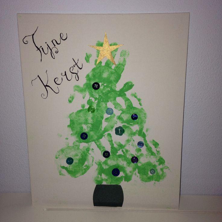 Kerstboom met handjes peuter.