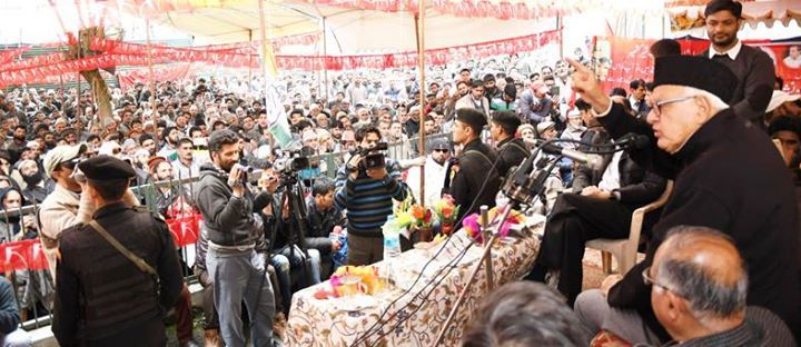 NC president Dr Farooq Abdullah addressing an election rally at Ganderbal.