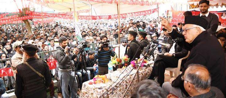 NC president Dr Farooq Abdullah addressing an election rally at Ganderbal.