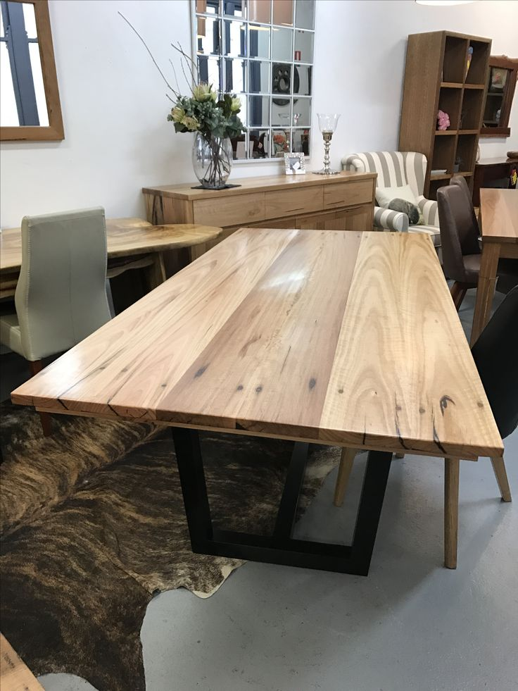 This dining table is made by Wildwood Designs, using reclaimed timbers from the Bearmen Park Footbridge in Marrickville Sydney with black Ellis design base.