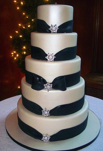 Gorgeous satin sheen wedding cake w/ midnight blue fondant ribbons and bling. Would LOVE to have sugar spun bling.