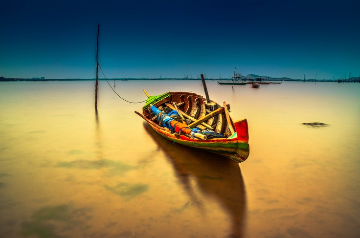 A fishing boat that was waiting for tides to be used for fishing in the waters of Riau islands, fishing boats Tanjung Riau Batam Island in Indonesia. Photo taken  by Raja Ghazali