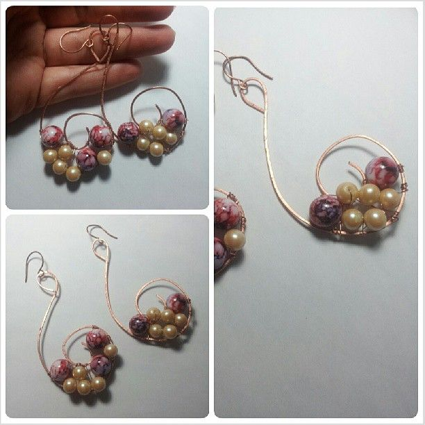 Copper's earring realized with wire techinque. There are many colorful stones included with copper wire. For info contact me! :)