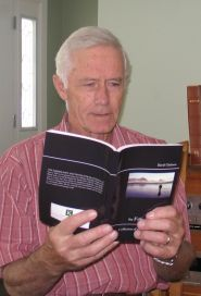 David Gislason with his book of original poetry and translations of Icelandic and North-American Icelandic poetry.  The title of his book is Fifth Dimension