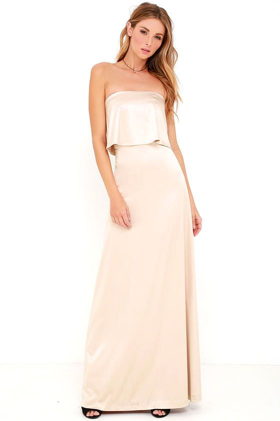 Perfect for any formal occasion, the Ever So Lovely Beige Satin Maxi Dress has an unmatched elegance! Sleek and stretchy satin knit falls from a strapless neckline (with no-slip strips) to a fluttering flounce that parts at back. Body-skimming skirt ends at a maxi length. Hidden back zipper with clasp. #fashion #style #streetstyles #popsugar #wachabuy #apparel #lulusdotcom #lulus #lovelulus