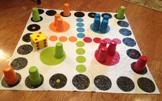 DIY Giant Trouble Game... Cost under $10 to make! White vinyl tablecloth and craft paint for game board. Craft foam and paint for the die. Game pieces are cheap plastic cups that come in a set of four.