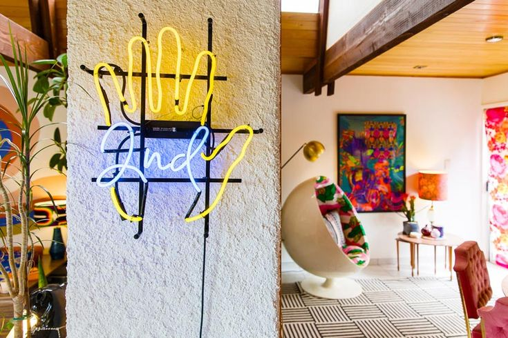 A Vintage Neon Sign Welcoming You To The Dining Room In This New Zealand Home On