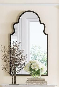 Add extra light to any room with our arched mirror that couples the shape of a Moroccan doorway with a rustic, hand-forged metal frame.