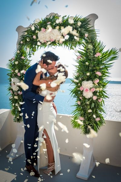 Now you may kiss the Bride!!! #love #first #kiss #bride #groom #santorini #traditional #wedding #planner