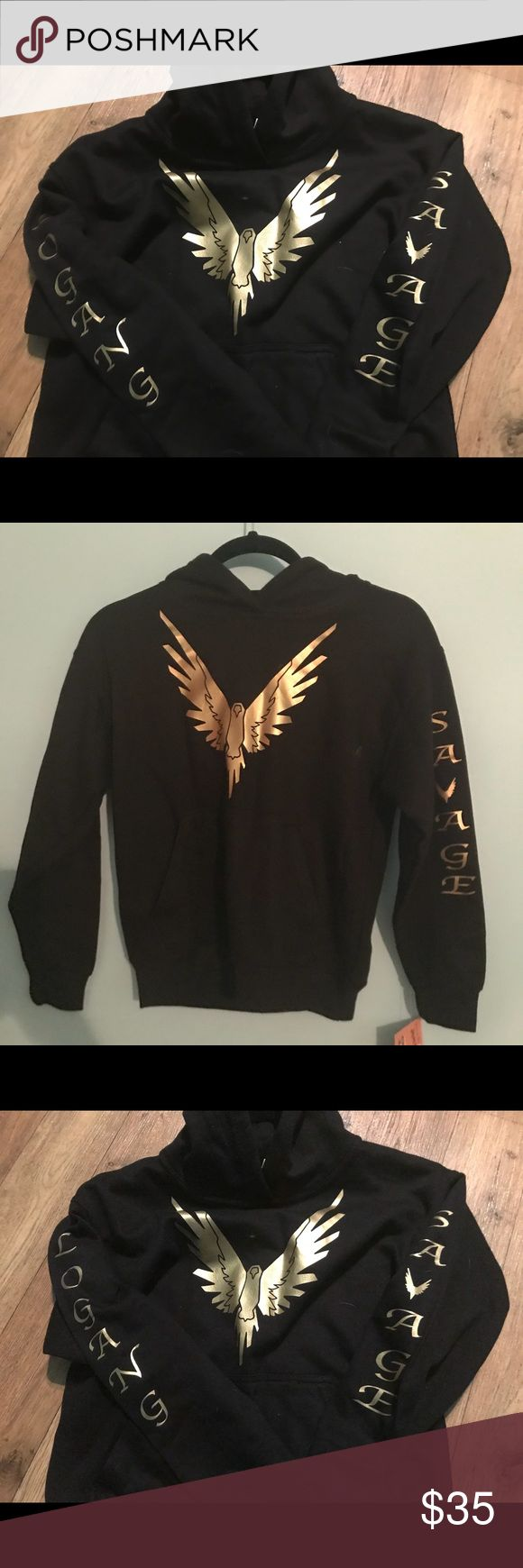 Logan Paul Logan Sweatshirt size m youth Trendy Logan Paul Logan Sweatshirt size m youth , GOLD SAVAGE & LOGANG Down the sleeves with the maverick logo on the front and gold, hoodie with kangaroo pocket new with tags Jackets & Coats