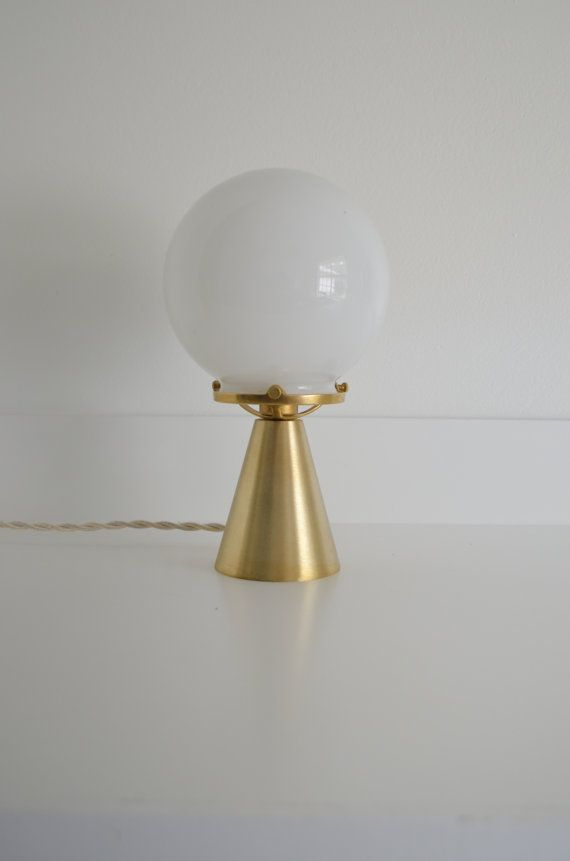 The Gypsy - No. T1 Table top lamp provides a great amount of light. Constructed from solid unfinished brass materials and a handblown glass globe.…