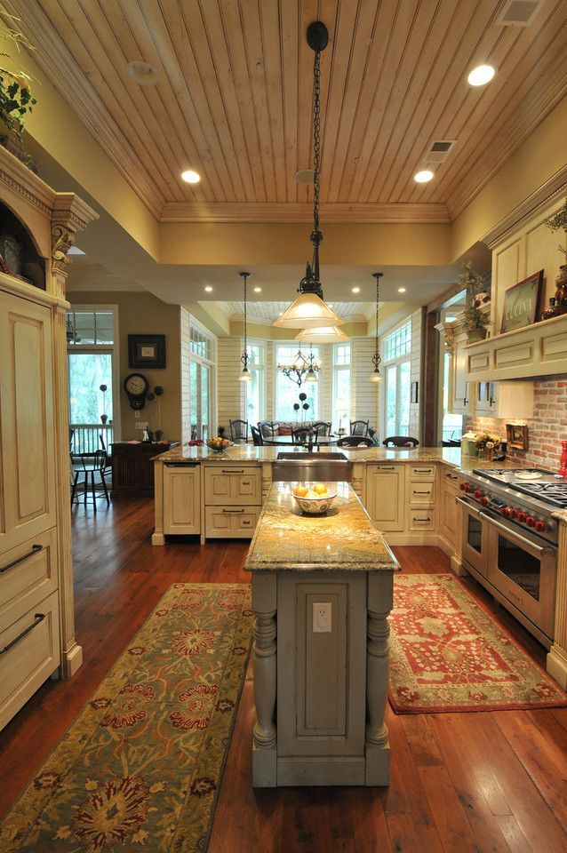 Southern Coastal Homes (With a bigger center island though) ceiling, dining, dishwasher drawers, stove, floor and lighting