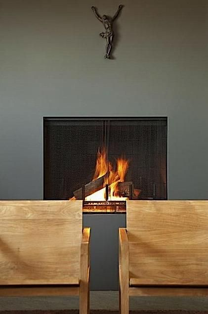 This frameless fireplace by Studio Tim Campbell becomes the main feature of the wall. Photography by Karyn Millet.