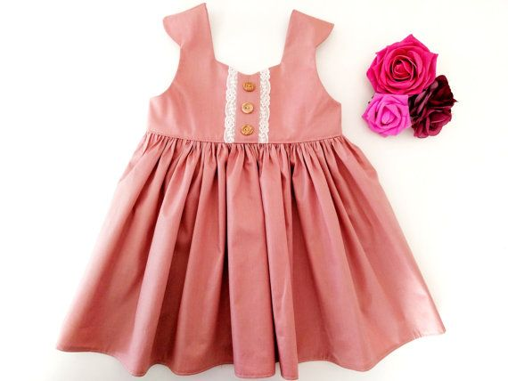 This stunningly simple pink baby dress works on its own as a summer dress, or add a cardigan and tights for a wonderful Christmas outfit. So versatile that it can be worn all year round! Click for sizing and price details!