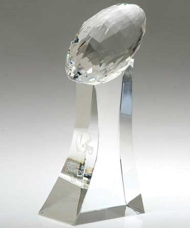 Glass Football Trophy  http://www.edco.com - This brilliant faceted glass football trophy is the ultimate way to congratulate a player or team for a job well done. Pass them out at the end of the season to your MVPs or hand them out to each player on your championship team.