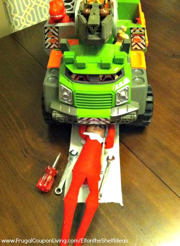 Elf on the Shelf Ideas – Elf is a Mechanic in this funny Elf on the Shelf Idea. New ideas added daily all November and December long plus FREE Printable Notes!