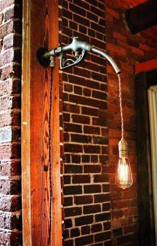 Nick and i are soon making this! Sweet lamp made from a gas pump handle.