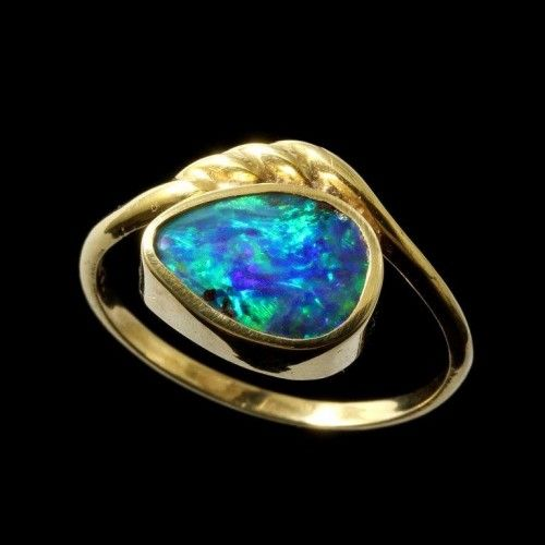 Stunning pear shaped black boulder opal ring set in 18k yellow gold bezel style., includes free black velvet gift boxing and shipping