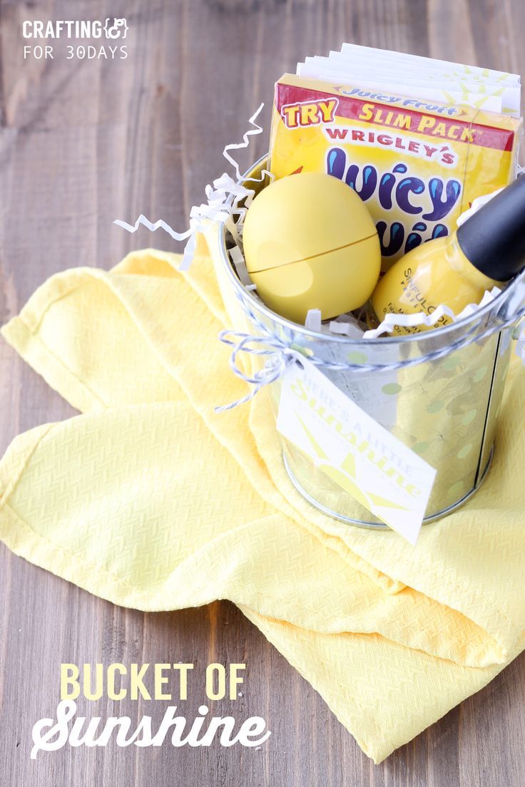 Bucket of sunshine with printable gift tags- full of bright yellow things to brighten someone's day. Free taggings and cards included.