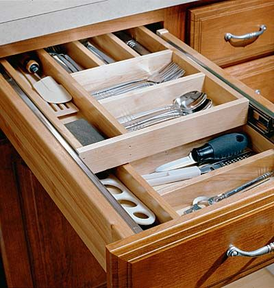 Two drawers in a space keeps silverware separate from meal preparation tools.