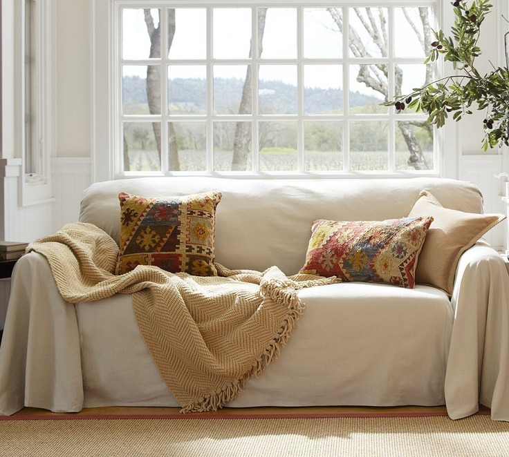 Inexpensive slipcover.  You can even use a painter's drop cloth for this.