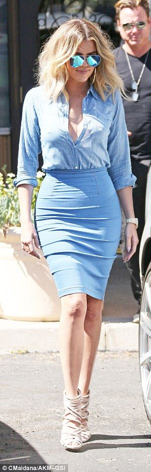 Careful now: Rolling up the sleeves, she opted against a bra, relying on the skirt's high ...