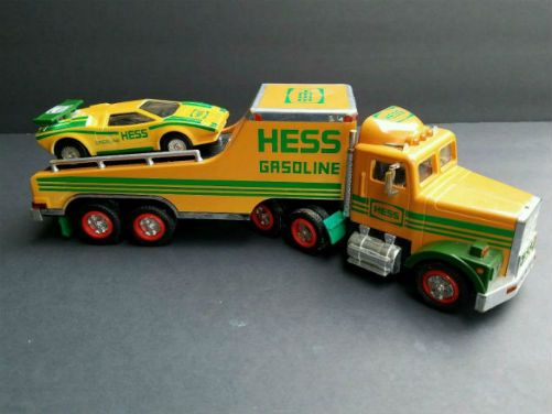 Vintage 1991 Hess Toy Truck and Racer. Modeled from the 1988 model the 1991 Hess Toy Truck and Racer was reconfigured to allow for continuous rolling action which kids love, speed! And the green stripes on the truck's sides created a more streamlined profile. What makes this model different compared to the 1988 model is the split windshield on the cab. The lighting is showcases the colors of lights, white, amber and red.
