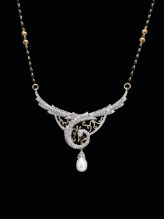 Beautifully Carved Peacock In 14 Kt Diamonds With A Hanging Pearl All In A Mangalsutra, Leaving Its Effect Wherever It Goes.