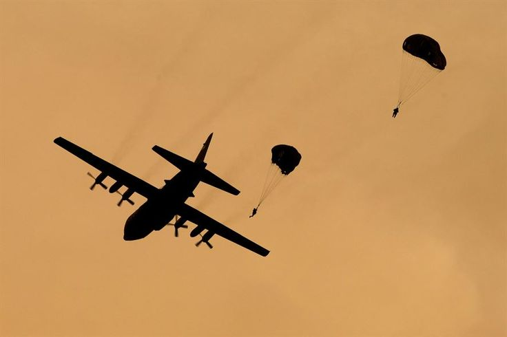 C-130 Hercules ~ Marines jump from an Air Force C-130 Hercules aircraft over the drop zone during Jump Week at Yokota Air Base, Japan, May 11, 2016. ~ BFD