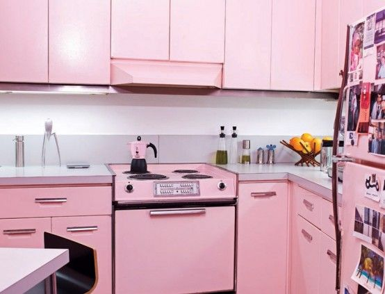 Painting appliances to match cabinets--This is a lot of pink, but I'm digging it. Would work in the right setting. I wonder what they used to paint everything?