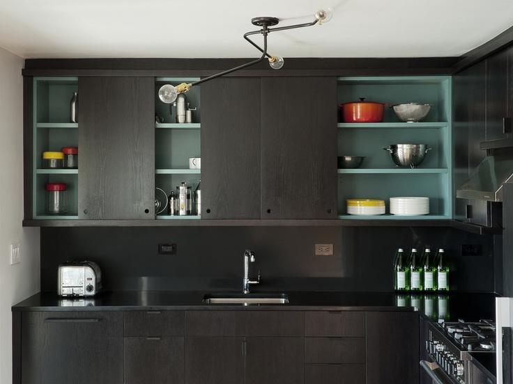 sliding door kitchen design + soft turquoise inside cabinets + industrial…