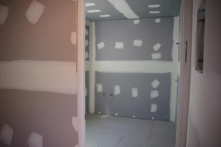 shipping container house diy back entrance and bathroom plasterboard