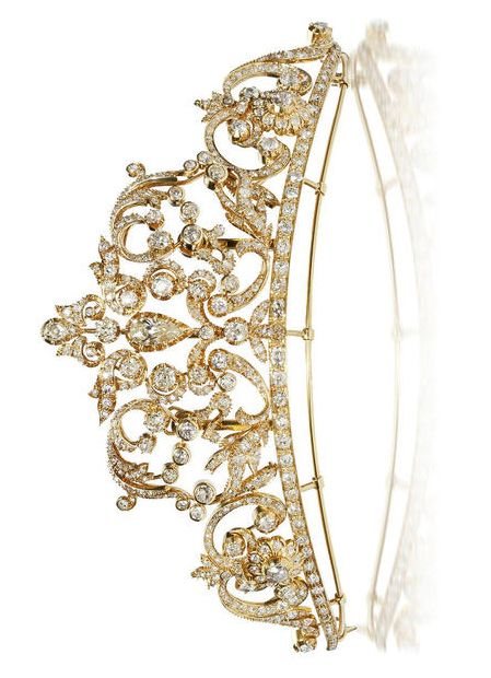 A diamond and eighteen karat gold tiara of tapered and openwork scrolling motif, centering a pear-shaped diamond and further set throughout with old European and old mine-cut diamonds