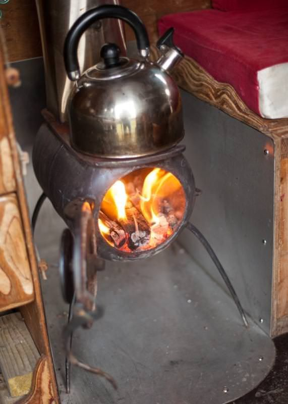 This little campervan woodburner was home-made using an old gas bottle, some reclaimed stainless steel and the prongs of a garden fork. Even the flue is from the scrap metal merchants! It gets the van super toasty in no time so we can happily camp in the snow...
