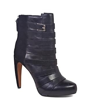 These black high heel booties make a firm style statement, with strappy details that go all the way up; from Sam Edelman.