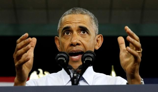President Barack Obama slammed Donald Trump's proposal to weaken Wall Street reforms and touted his own economic record on Wednesday during a trip to a city he visited three weeks into his presidency that has recovered from its recession lows.
