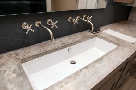 The custom countertop and hardware in the master bathroom of the newly renovated Ridley home, as seen on Fixer Upper. (after)